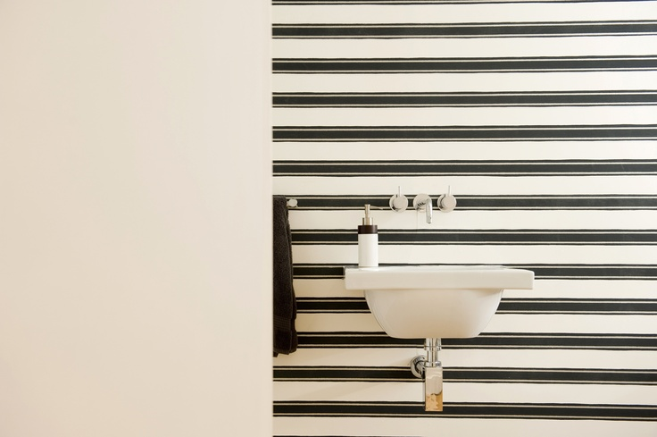 Bathroom wall in Farrow & Ball's cross-hung, 'Special Edition I Block Print Stripe BP 754' wallpaper