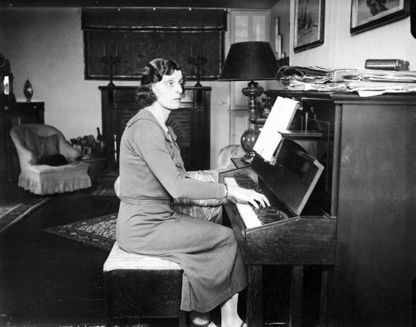 Mrs. Elizabeth M. Dashwood, aka author E.M. Delafield, playing the piano at home. Location:United Kingdom Date taken:1927