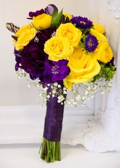 I love this bouquet.  I would add a few white flowers to really make the purple and yellow pop!