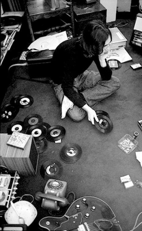 John Lennon with his records.