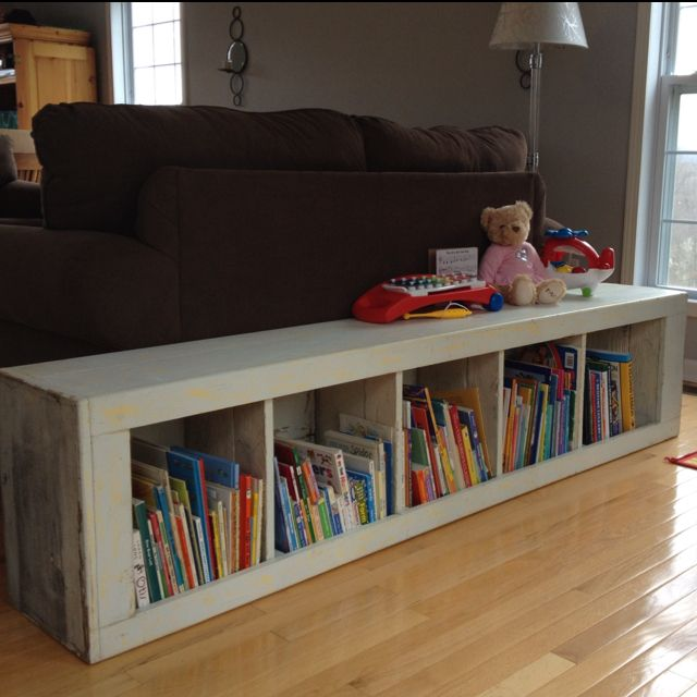 Upright bookshelf laid down; for kids book storage & play space on top!! Basement maybe?