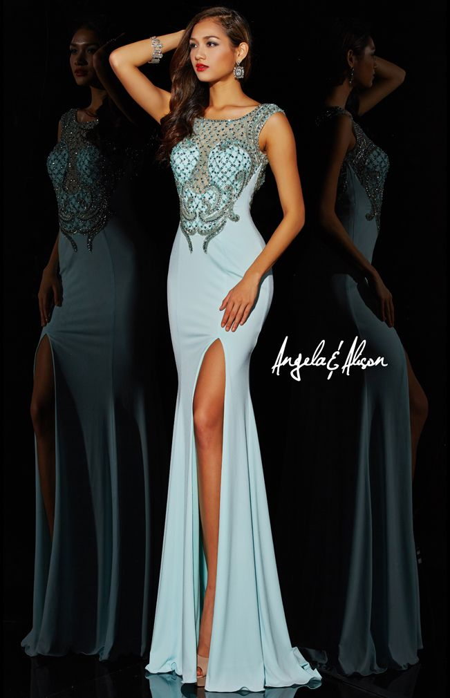 Style 51008 Bateau beaded neck line with jersey material with a long skirt and slit. Prom, homecoming, formal, pageants and dances.