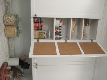 hidden cork board to store recipes, coupons, etc.  Use cork tiles - rolled cork doesn't work as well.