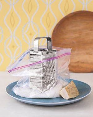 "Zippered Plastic Bag as Grated Cheese Catcher - Place the grater in a bag and keep it there as you shred a block of cheese. The bag catches all the shavings, and the kitchen counter stays clean. It's just another reason to smile when you say ""cheese."""