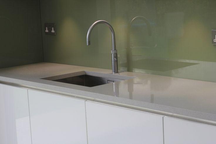 Silestone Aluminio Nube Grey / Silver quartz worktops with green glass splashback and undermount sink. Installed in Wimbledon, London.