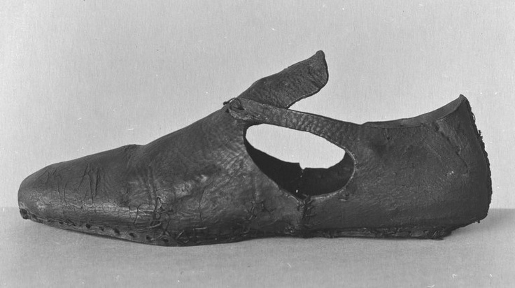 Shoe-Circa 1600   Excerpt: Left shoe of leather with round toe and open side. Only one latchet (left side) is remaining, originally tied over tongue (parts missing).