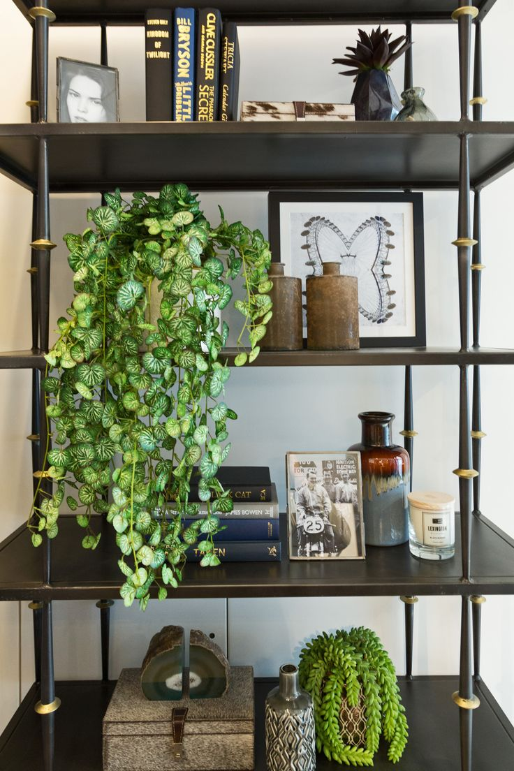 Contrasting the urban industrial flair with a wholesome, organic ambience, we used naterial materials in our styling of this study's bookcase, punctuating with bright green tones of verdant vitality.