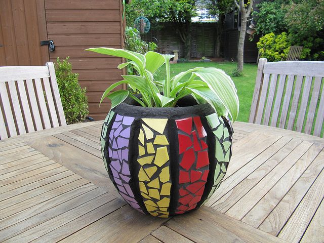 Mosaic Plant Pot, by Vicky The bold colours of the mosaic stripes on this pot, set against the black grout create such a striking effect. It looks so beautiful in the garden, too
