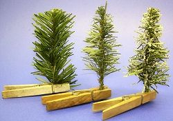 How to stand fake trees in your Fairy Garden...... Cover clothes pins with moss, or rocks, or sand, or whatever you'd like.