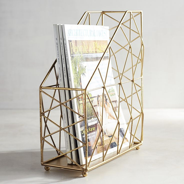 Lessen stress and clutter with our exclusive magazine holder. Its modern dimensional design, with iron construction and gold foil finish, keeps important magazines, documents and folders arranged neatly. And looking totally glam.