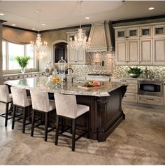 Kitchen ideas. Glass tile backsplash. Kitche island. Beige cabinets. White/ black counterstool.