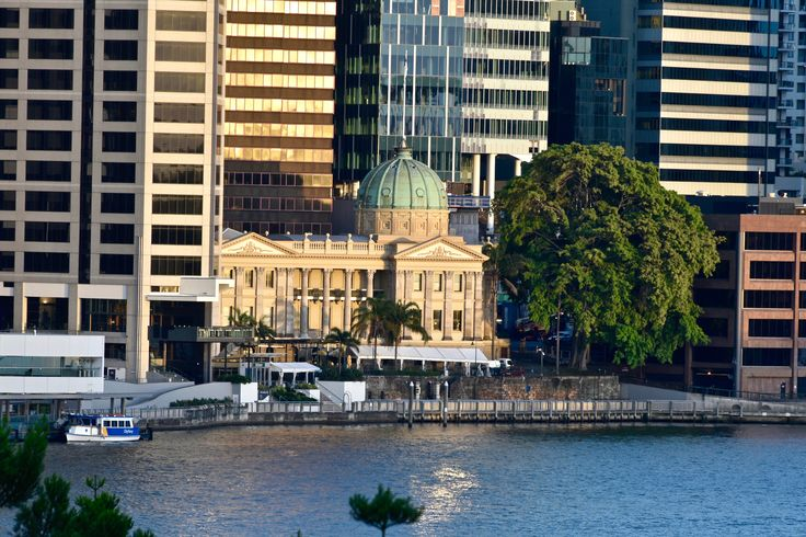 Old and new - The historic Customs House in Brisbane, Australia, surrounded by modern buildings. Image taken from Kangaroo Point cliffs by Neale Maynard