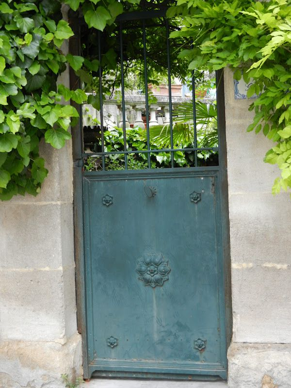 French gate in blue, concrete block if you have nice landscaping isnt all that noticeable, front with a facing at prime focal points like this