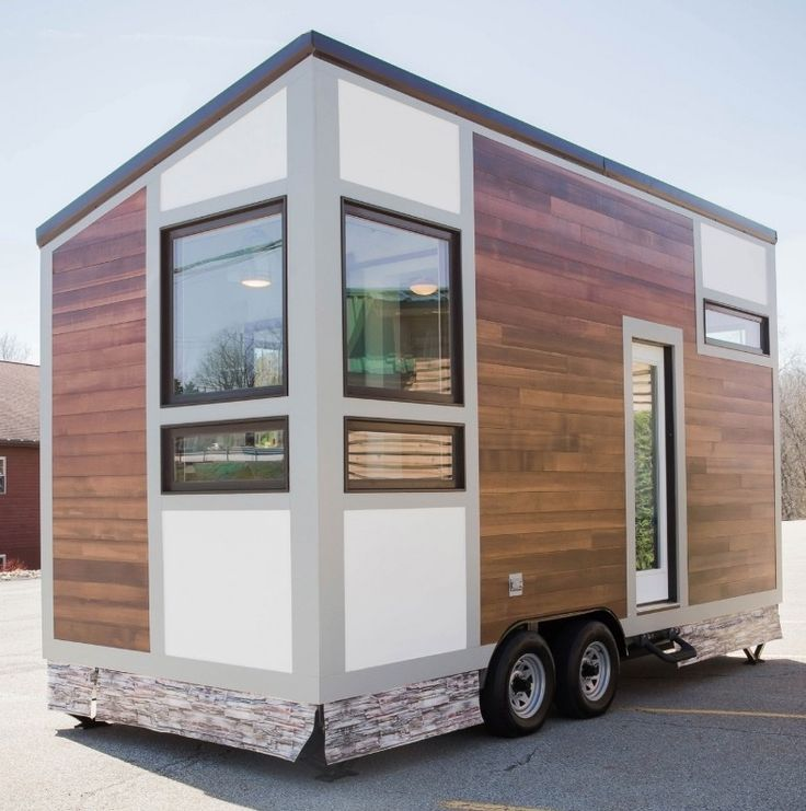 This is the Degsy Tiny House by 84 Lumber Tiny Living. It's a 160 sq. ft. modern looking tiny home on wheels with a slanted roof. Inside, you'll find a…