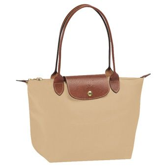 The exact bag my boyfriend got me this past Christmas. I almost exchanged it for a dark colour but decided to live up to the careful, responsible, graceful image that is necessary for a light coloured bag. I use it almost everyday and it still looks pretty great!