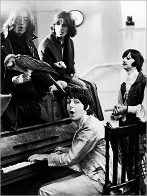 The Beatles | The fifth Beatle? The band, with an unnamed feathered friend, in 1968