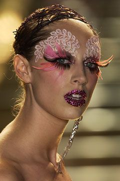 Creative runway make-up with lace, feather lashes and bejeweled lips by Dior.