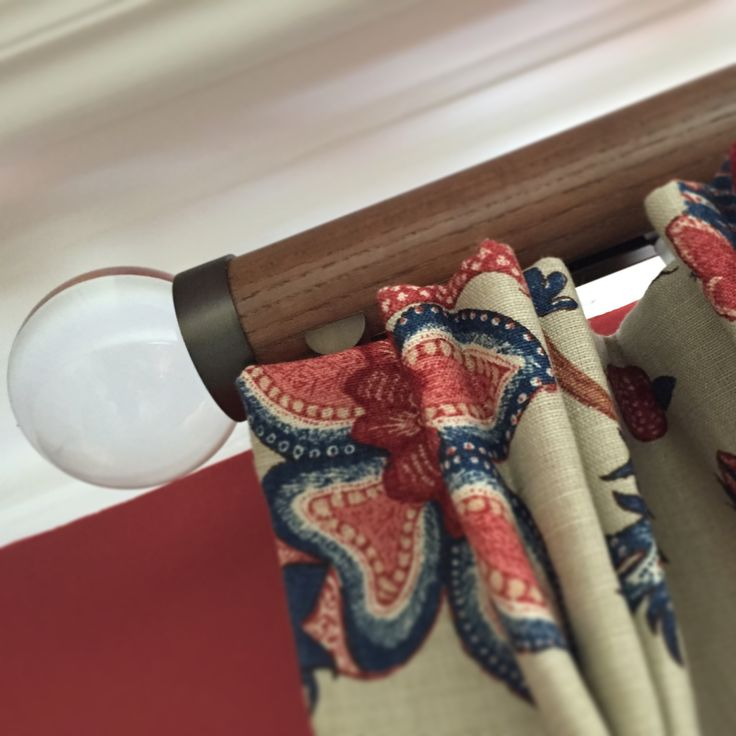 Curtain pole by Walcot House - beautiful glass finial on stunning walnut pole.  Interlined triple pleat curtains hand made by Victoria Clark Interiors.  Fabric by GP&J Baker.