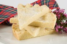 Shortbread has been attributed to Mary, Queen of Scots, who in the mid 16th century was said to be very fond of  Petticoat Tails, a thin, crisp, buttery shortbread originally flavoured with caraway seeds.