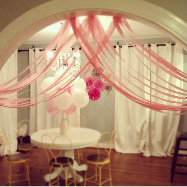 pink crate paper in waves- bottle filled with ballons- paper fans made with pink white purple paper