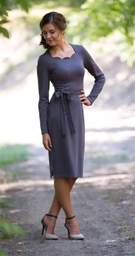 This dress is an absolute must have! Available in three beautiful colors. The Reagan features a scalloped neckline, long sleeves and tie waist band.