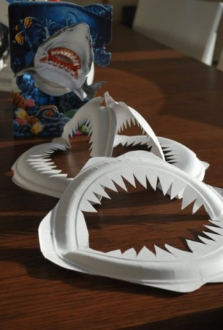 Paper plate jaws decoration for a Shark Week party.