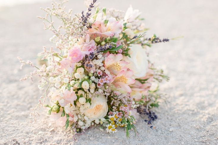 Wildflower bride romantic bouquet in pastel colours by Gourioti Flowers Andrea Rufner Photography