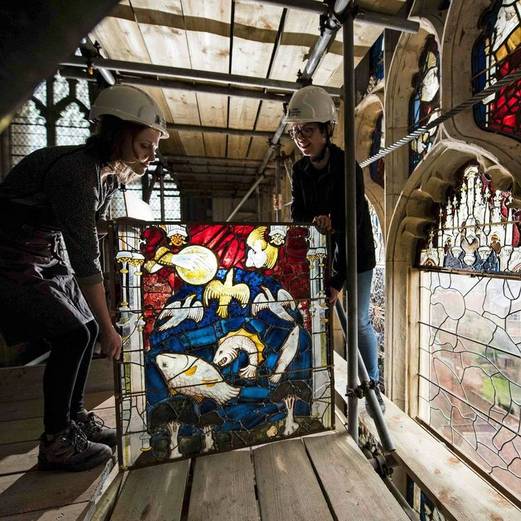 Conservators Zoe Harrigan and Anna Milsom replace the final stained glass panel in York Minster's 600 year-old Great East Window, following a 10-year conservation and restoration project, in York, England on January 2nd 2018. All 311 panels of the window, which is the country's largest single expanse of medieval stained glass, were removed and restored by York Glaziers Trust - a task which took 92,400 hours and cost £11.5 million. The window, which is the size of a tennis court, was created…