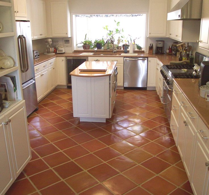 Kitchen with mexican tile installed on a diagonal and pulled for slightly less color variations.  Authentic Mexican Saltillo Tile is a form of Quarry flooring.  It's clay tile fired at extreme temperatures for superb quality terra cotta flooring.