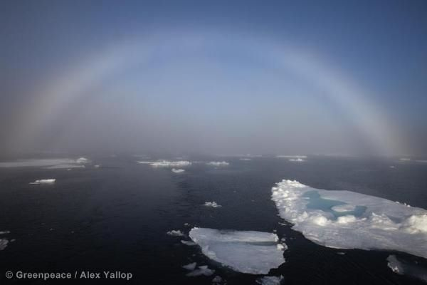 Rainbow over the Fram Strait sea ice, seen from the Greenpeace ship, Arctic Sunrise. 13 Jul, 2012 © Greenpeace / Alex Yallop