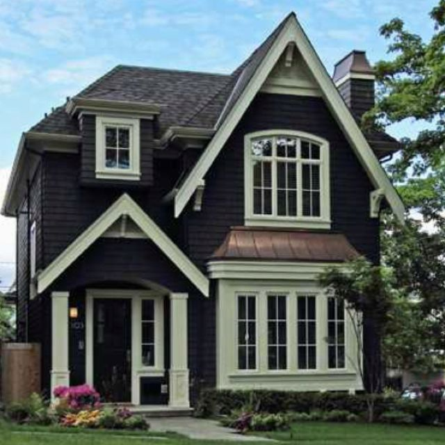 This exterior brings together all the elements I love.  10 &12 pitch roof lines, shake siding, dramatically contrasting trim, curved copper dormer, corbels, a single arched window that echos the arch over the door, all topped off with  the perfect copper chimney cap.   Bravo.: