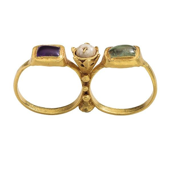 Two-Finger Ring Date: early 6th century Culture: Byzantine Medium: Gold, amethyst, emerald, glass, pearl