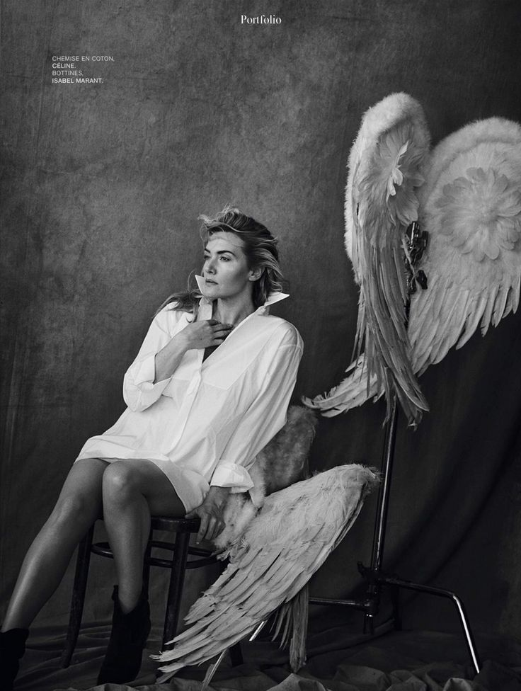 Kate Winslet poses with wings while wearing Celine top and Isabel Marant boots