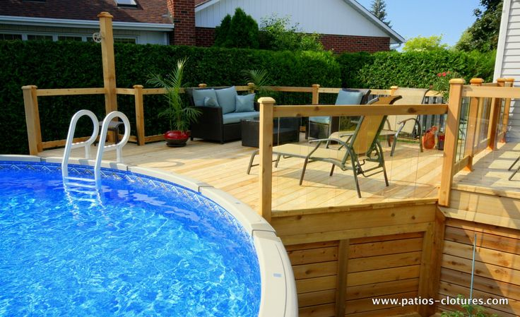 A deck with a large pool deck, perfect for swimming and relaxating.