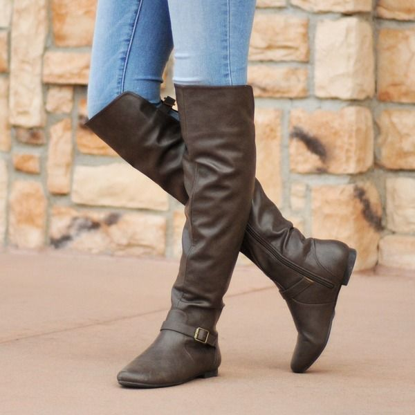 Show off classic knee-high boots from Journee Collection. Theseboots feature premium PU uppers with raised vamps in the front.Classic round toes and an ankle strap design with buckle accentscompletes