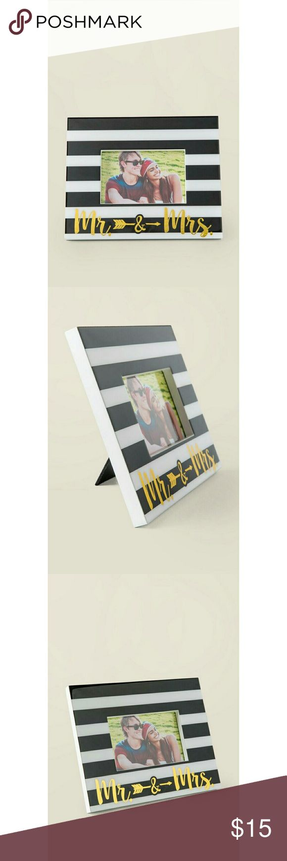 MR. & MRS. ARROW STRIPED FRAME - 10 inches by 8 inches - Fits a 4 inch by 6 inch photo - Black and white striped design - Gold font - Stand on back for propping up - Lacquer coating on front - Francesca's exclusive - Imported Francesca's Collections Other