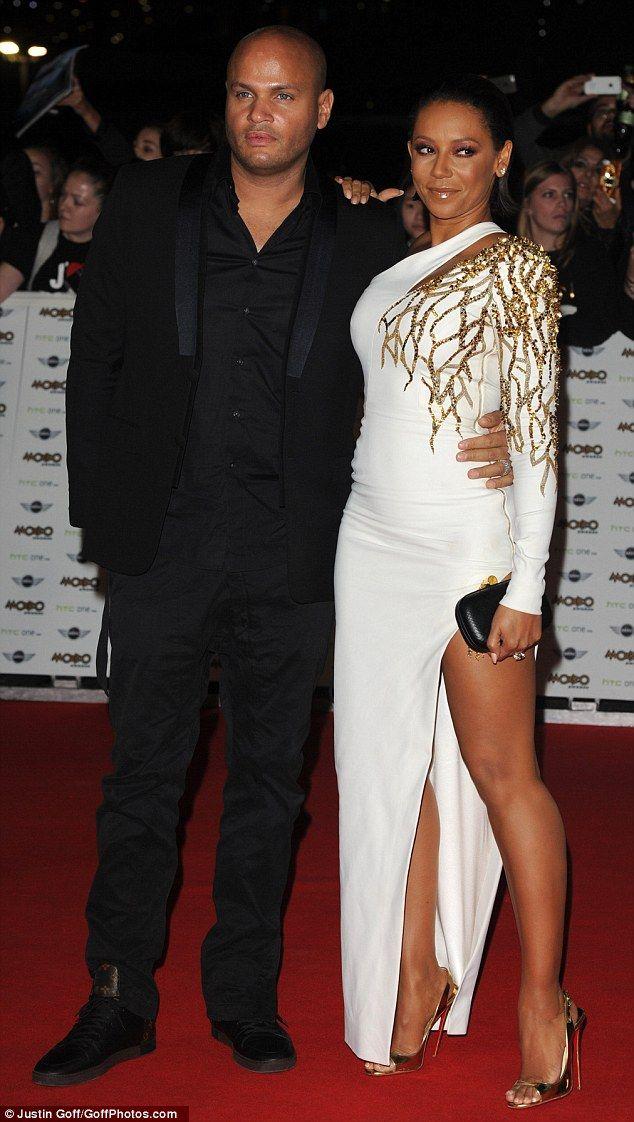 Date night: Mel B arrived at the lavish bash with her husband Stephen Belafonte...