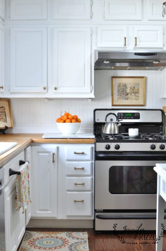 white kitchen cabinets brass hardware rizzo kitchen white painted kitchen cabinets with 28706