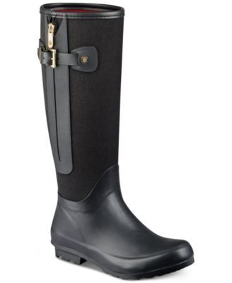 Strap and buckle details and a zipper give Tommy Hilfiger's Mela rain boots the stylish appeal of a riding boot in materials that make facing the weather a cinch. | Fabric/rubber/manmade upper; manmad