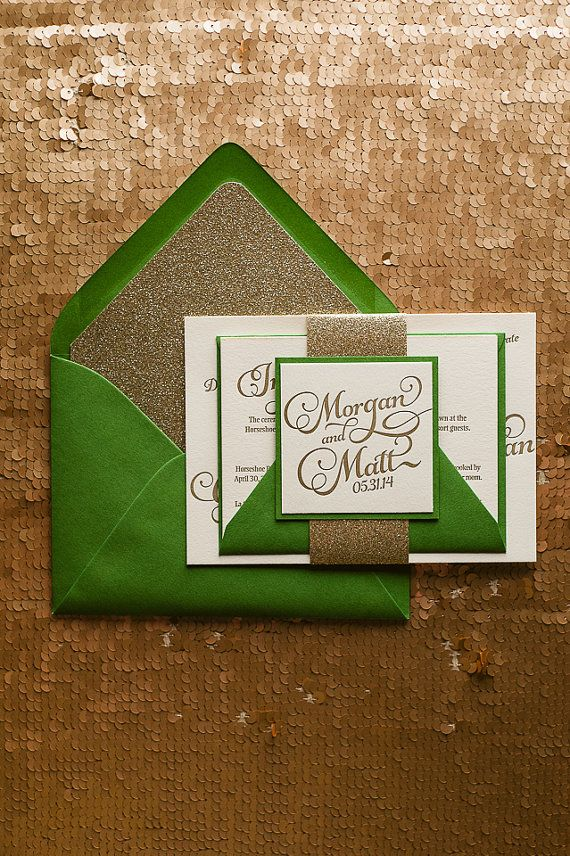 This regal emerald green & gold letterpress wedding invitation suite features a calligraphic font paired with a block font for all of the
