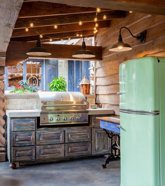 Rustic Outdoor Kitchen With Pretty Barn Lights And Jadeite Green Big Chill Fridge Enjo Rustic Outdoor Kitchens Outdoor Kitchen Appliances Outdoor Kitchen