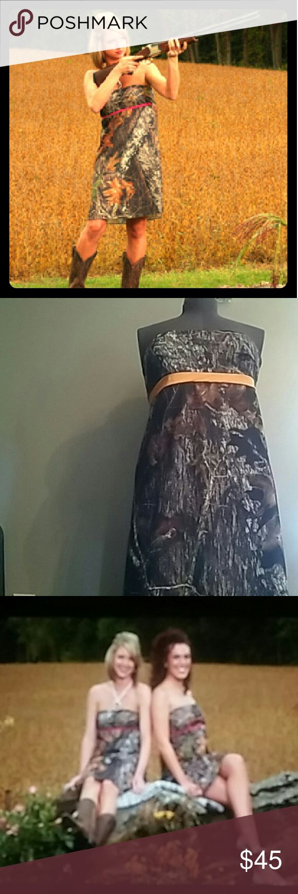 Camouflage Strapless Dress The cutest, most versatile camo dress around. This little camouflage dress looks great with boots or with heels. Wear as a camo party dress, camo bridesmaid dress or camouflage prom dress. Dress it up, dress it down, wear it everyday. Strapless top with feminine cut. Trim just below the bust is a fun detail and comes in blaze orange. Elastic at the top of the bodice. The fabric is in Mossy Oak New Break Up and has a little shine to it as well as stretch.  Bust…
