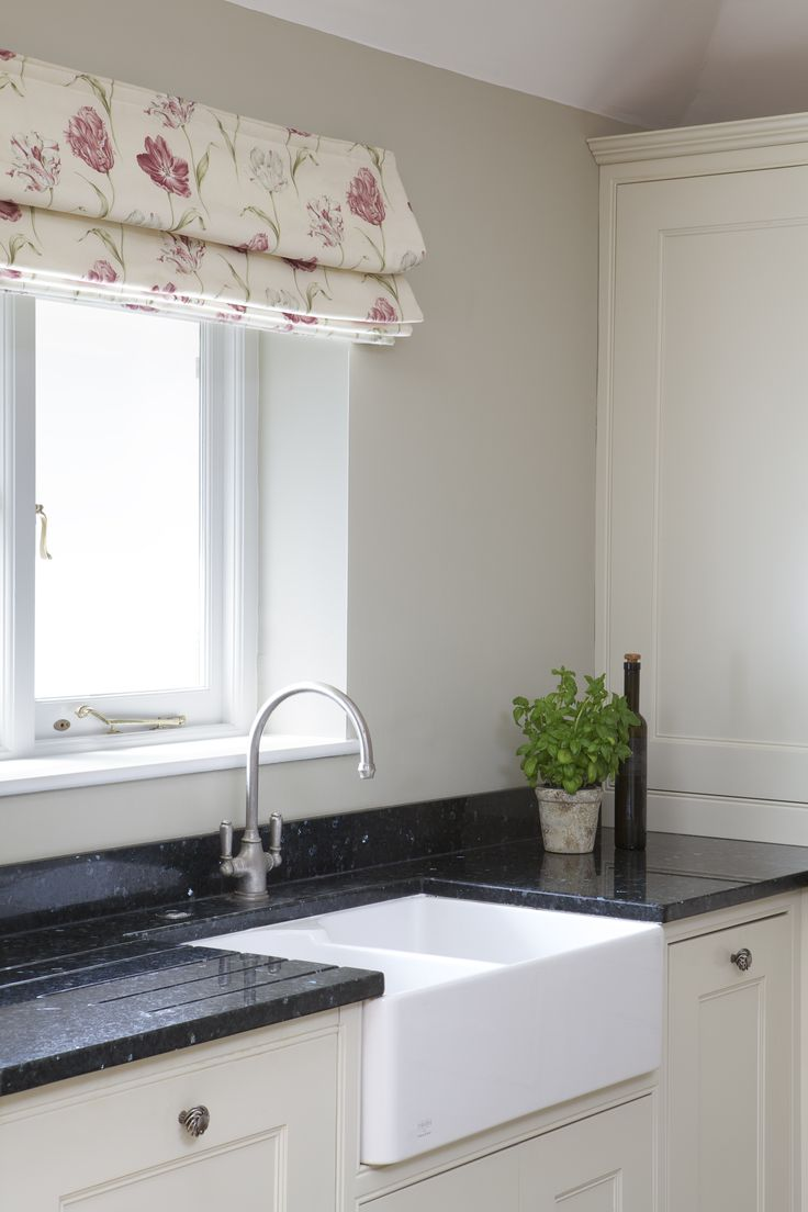 Walls in Farrow  Ball's Clunch  Cabinets in Wimborne White.  Love the look of the farmers sink  high faucet.