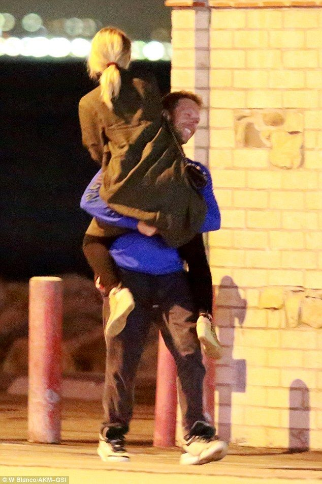 Careful she doesn't have a Rush Of Blood To The Head: The Coldplay frontman looked like we having a ball larking around with his new girlfriend