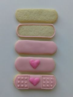 easy Doc Mcstuffin cookies. Mary's sugar cookies... purple icing and a pink  icing pen...