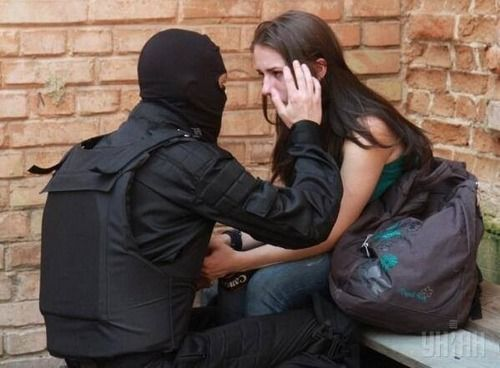 Is he a bank robber, terrorist, policeman helping a girl who is terrified because...