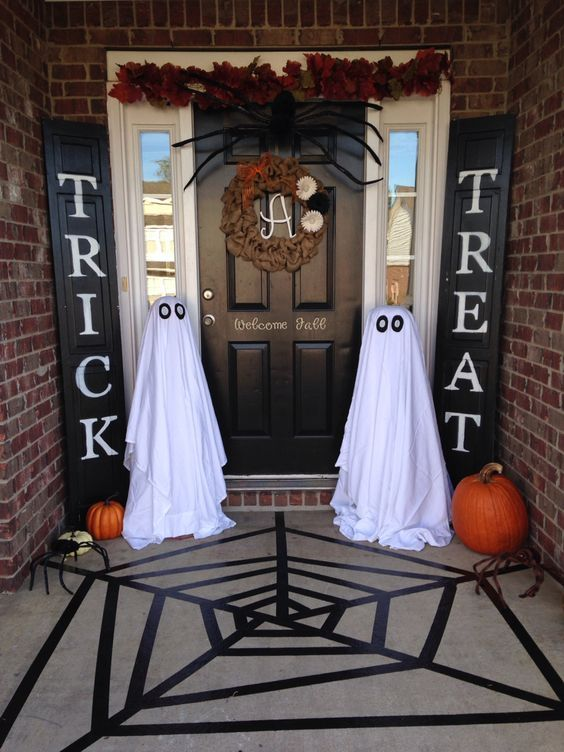 trick or treat signs and simple ghosts made of sheets
