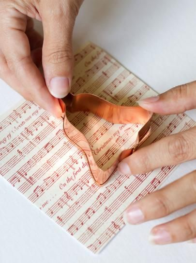 Glue Metal Cookie Cutter to Music Sheet Paper