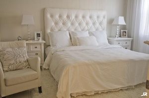 White tufted headboard and white nightstands