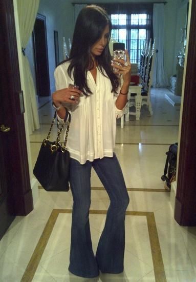 I want this outfit in my closet. loose top with flare jeans